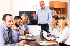 Boss and stressed co-workers Royalty Free Stock Photo