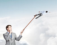 Boss and subordinate. Businessman holding on lead another escaping businessman Royalty Free Stock Image