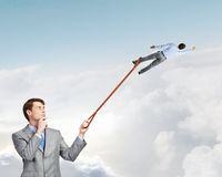Boss and subordinate. Businessman holding on lead another escaping businessman Stock Images