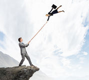 Boss and subordinate. Businessman holding on lead young colleague businesswoman Stock Photo