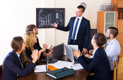 Boss with subordinate officials discussing stock images