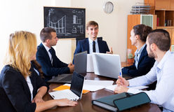 Boss with subordinate officials discussing. Long-term forecast and smiling Royalty Free Stock Images