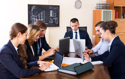Boss with subordinate officials discussing stock image