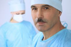 Boss surgeon is examining the operation while medical team are busy of patient. Medicine, healthcare and emergency in. Hospital Royalty Free Stock Images