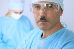 Boss surgeon is examining the operation while medical team are busy of patient. Medicine, healthcare and emergency in. Hospital Royalty Free Stock Photo