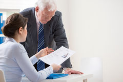 Boss talking with job candidate Stock Image