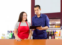 Boss teaches to the saleswoman Royalty Free Stock Images
