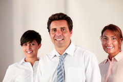 Boss team smiling and looking at you Stock Photo