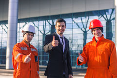 Boss and  team of  young engineers showing thumbs up Stock Photography