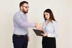 The boss tells the worker what to do in the office royalty free stock photography