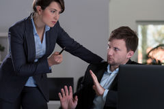 Boss threatening to her employee Stock Photo