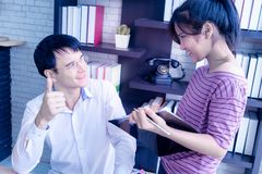 Boss thumb up for worker compliment. Boss thumb up for female worker compliment royalty free stock photos