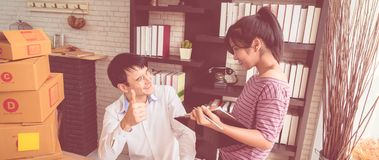 Boss thumb up for worker compliment. Boss thumb up for female worker compliment royalty free stock photography
