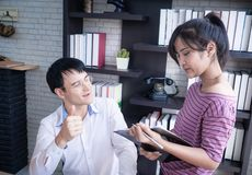 Boss thumb up for worker compliment. Boss thumb up for female worker compliment stock photos
