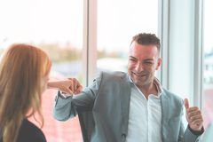 Boss thumb up for worker compliment. Boss thumb up for female worker compliment stock images