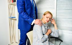 Boss touch shoulder of female office colleague. Tired woman worker relaxing while man massaging her. Behavior rule and. Boss touch shoulder of female office stock photo