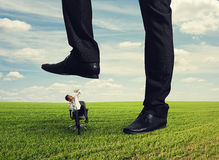 Boss trampling down bad worker Stock Images