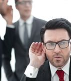 Boss is trying to hear gossip. Photo with space for text stock images