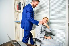 Boss unacceptable behavior with subordinate employee. Boss touch shoulder of female office colleague. Tired woman worker. Boss unacceptable behavior with royalty free stock photography