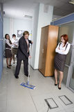 Boss washing the floor in office. Stock Photography
