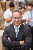Boss wearing eyeglasses standing with arms crossed Royalty Free Stock Image