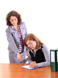 Boss woman dictating to her assistant. Boss women dictating to her assistant isolated on white Royalty Free Stock Images