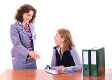 Boss woman explaing to her assistant happily Stock Photos