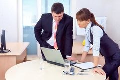 Boss and woman working in office Stock Image
