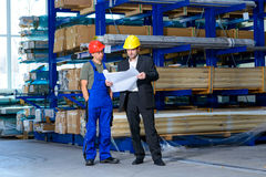 Boss and worker in conversation Stock Image