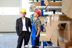 Boss and worker in conversation Royalty Free Stock Image