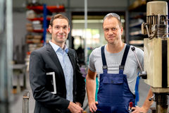 Boss and worker in conversation Stock Photo