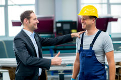 Boss and worker in conversation. Young boss and worker in conversation Royalty Free Stock Photos