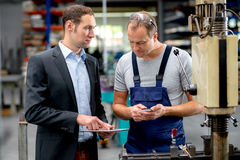 Boss and worker in conversation Stock Images