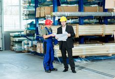 Boss and worker with plan  in conversation Stock Image