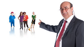 Boss and workers. A boss or a politician, whatever you might think of is showing ordinary people behind him Royalty Free Stock Images