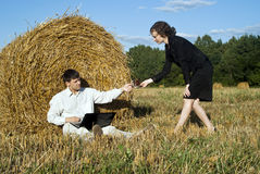 Boss in working. Teamwork at the nature. two person and laptop Stock Images