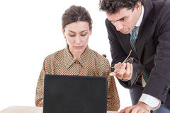 Boss and worried secretary working together on laptop Royalty Free Stock Images