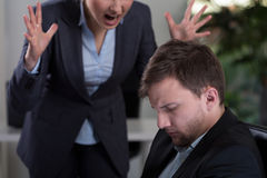Boss yelling at employee. Female boss yelling at employee at work Stock Photography