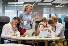 Boss yelling at employees in meeting room Royalty Free Stock Photo