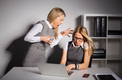 Boss yelling at her employee. In the office Stock Photography