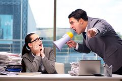The boss yelling at his team member Stock Images