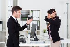 Boss Yelling At Secretary Covering Ears Stock Photos