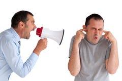 Boss yelling at a subordinate megaphone. Boss yelling at a subordinate through a loudhailer Stock Photos