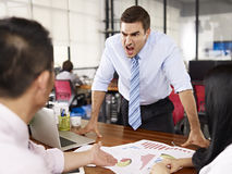 Boss yelling at subordinates Royalty Free Stock Photo