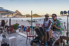 Bossa Nova and Samba in Copacabana Beach. Rio de Janeiro, Brazil - Dec 17, 2017: Band playing bossa nova and samba at a kiosk on Copacabana Beach, Rio de Janeiro stock images