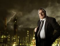 Bossy. Portrait of nasty businessman on industrial background Royalty Free Stock Images