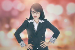 Bossy businesswoman with bokeh background Stock Photos