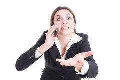 Bossy female manager asking answers or explanations over the pho Stock Image