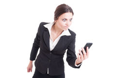 Bossy, furious and angry business woman on live video call. Isolated on white background Stock Image