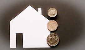 Bostadslån- eller köpillustration med mynt arkivbilder